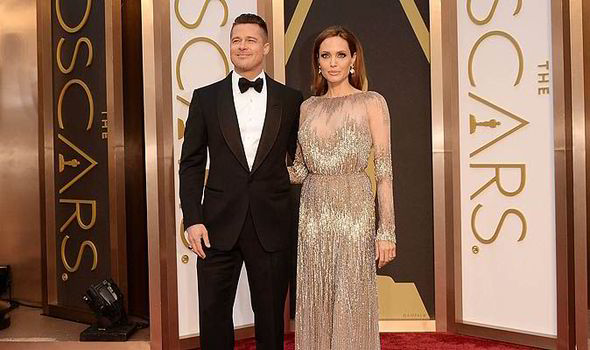 Brad_Pitt_Angelina_Jolie_oscars_2014_couples_power_couples_style_red_carpet-462746.jpg