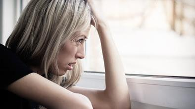 woman looking out window.jpg