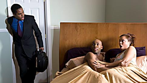 a man walks into a bedroom to find wife with another man in bed