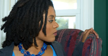 fear of divorce: beautiful african american women with worried look on her face.