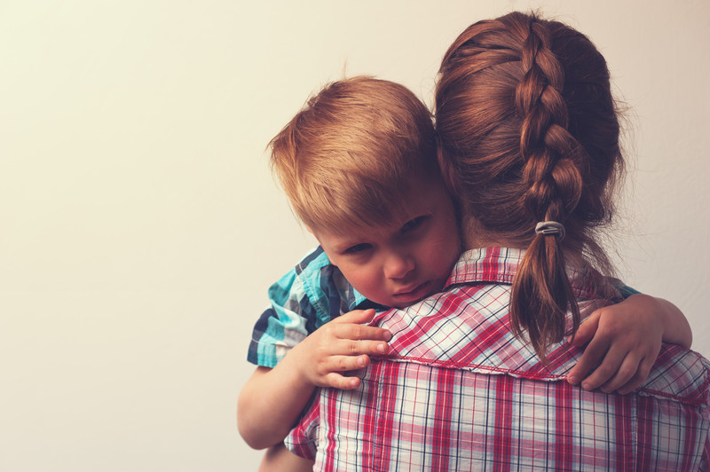 make divorce easier on our children: redheaded mom hugging sad son