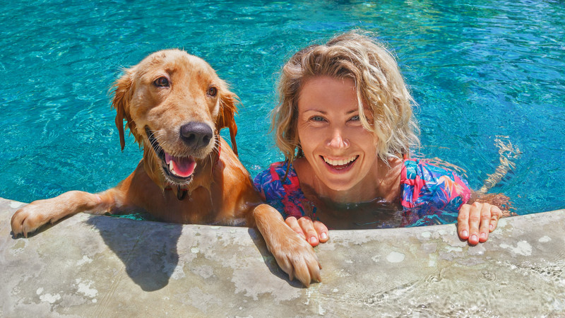 perks of divorce: woman with golden retriever in a pool