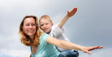 single mom: mom and son with arms spread like winges