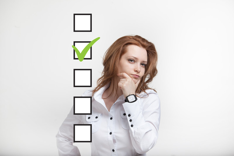 post-divorce checklist: woman looking at a list of things to do