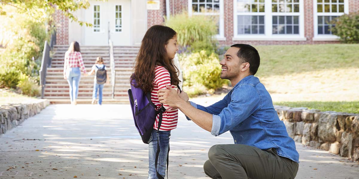 right of first refusal: divorced father picking his daughter up after school