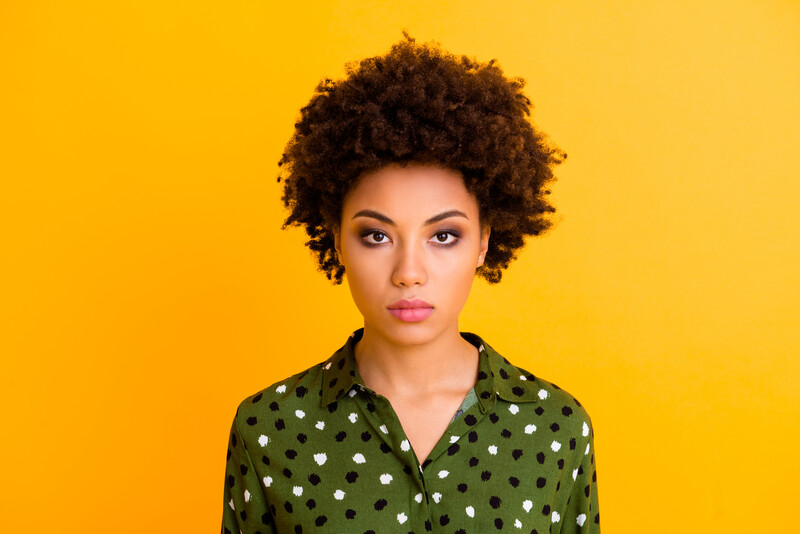 make divorce painless: serious african american woman on yellow background