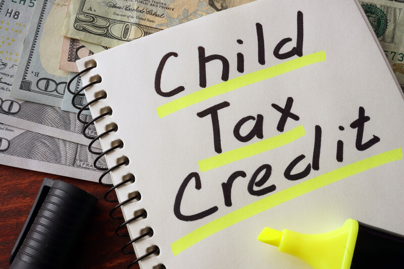 notebook with the words child tax credit written and underlined