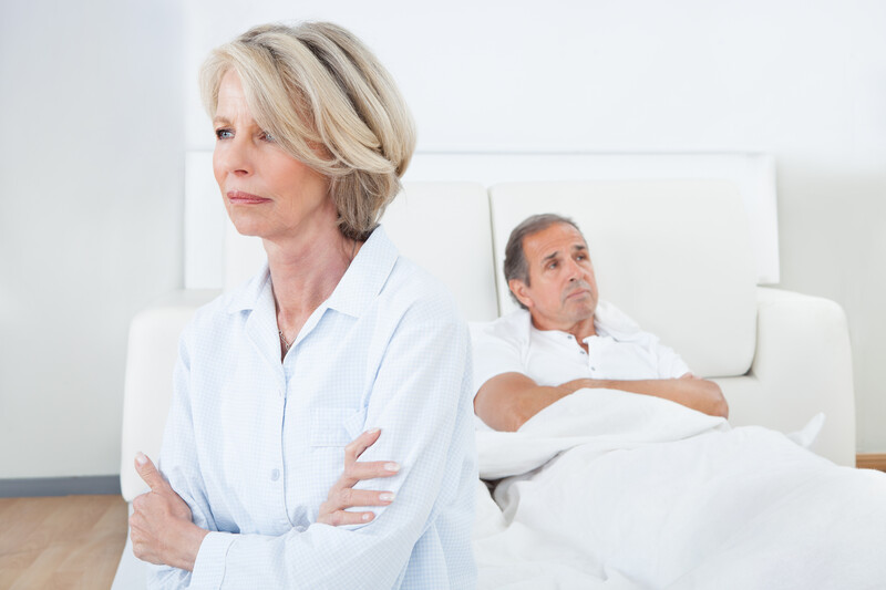 defensive with your partner: couple in bed wife upset and angry