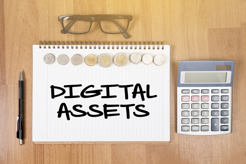 digital assets during divorce: Notepad on a desk with the words digital assets written on it